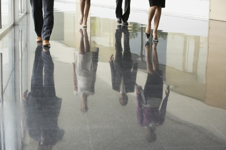 business woman legs: Businesspeople Walking
