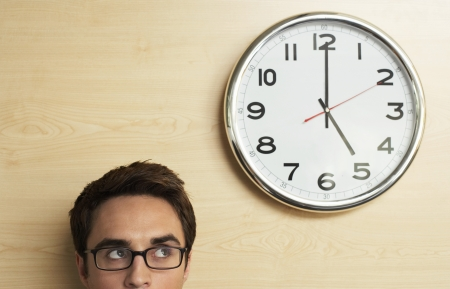 time limit: Businessman Looking at Clock LANG_EVOIMAGES
