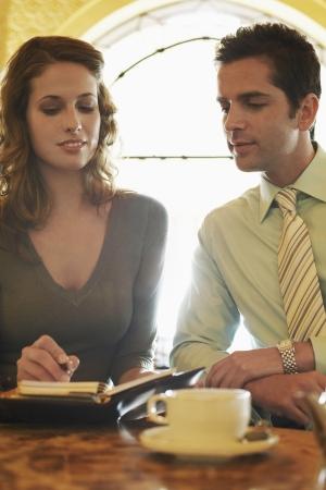 opting: Business People Choosing a Date