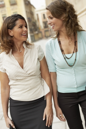 mingle: Two Businesswomen Talking Outdoors LANG_EVOIMAGES