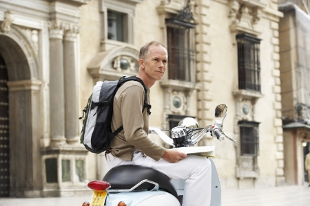 early 40s: Tourist With Scooter in Square