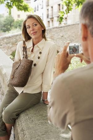 late 40s: Tourist Couple Using Digital Camera
