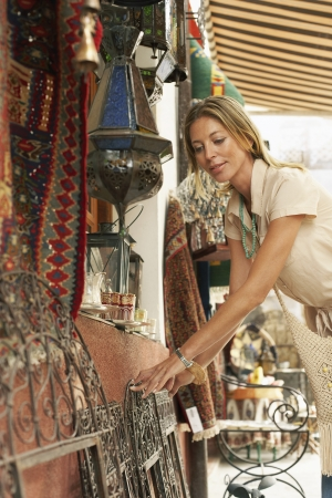 holidaymaker: Tourist Shopping for Bags on Stall