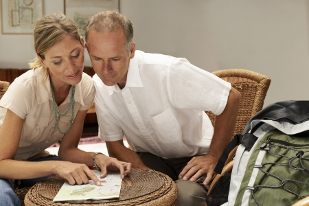 late forties: Tourist Couple in Cafe
