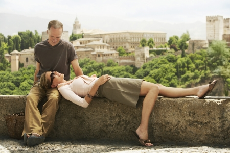 early 40s: Tourist Couple Relaxing on Wall LANG_EVOIMAGES