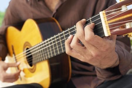 spaniards: Man Playing Guitar