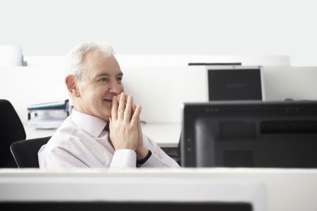 microcomputer: Thoughtful Senior Businessman LANG_EVOIMAGES