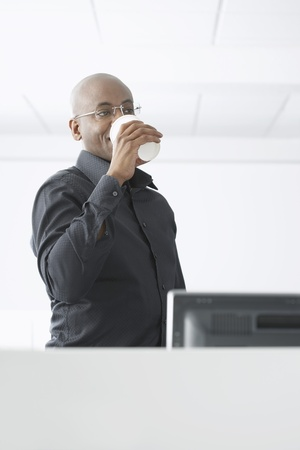 microcomputer: Office Worker Drinking Coffee