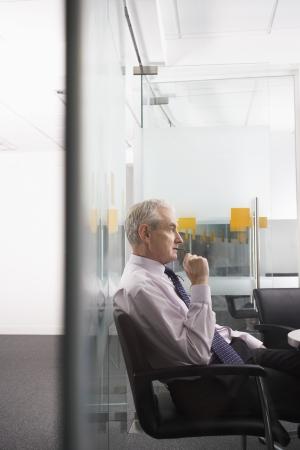 late 50s: Pensive Senior Businessman