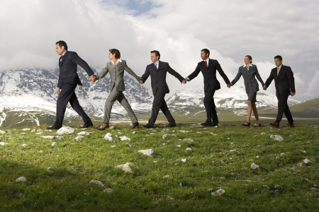 team mate: Business People Holding Hands and Walking LANG_EVOIMAGES