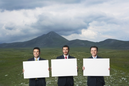 late forties: Business People Outdoors Holding Blank Signs