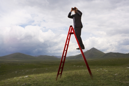 corporate ladder: Businessman with Binoculars on Ladder LANG_EVOIMAGES