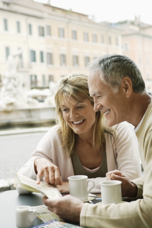vacationing: Couple Sharing a City Map