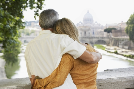 arms behind head: Older Couple on Vacation