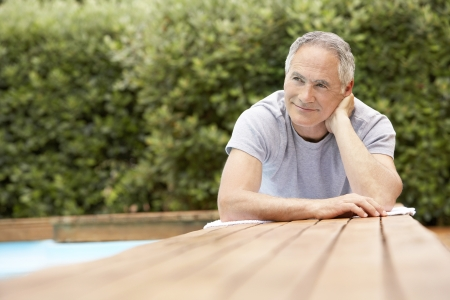 only one senior adult man: Older Man Relaxing by Pool