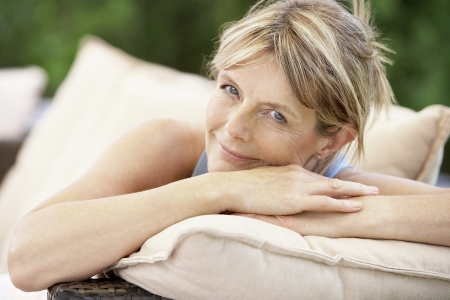 mature women only: Woman Relaxing Outside LANG_EVOIMAGES