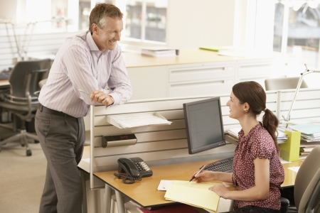 conversational: Office Workers Having a Conversation LANG_EVOIMAGES