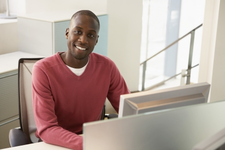 african american male: Man Working at his Desk