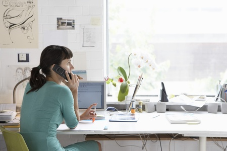 home office desk: Woman Using Cell Phone