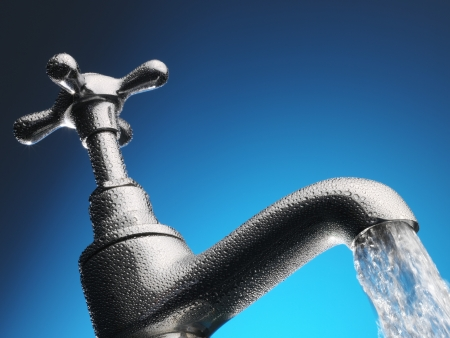Water pouring from tap close-up