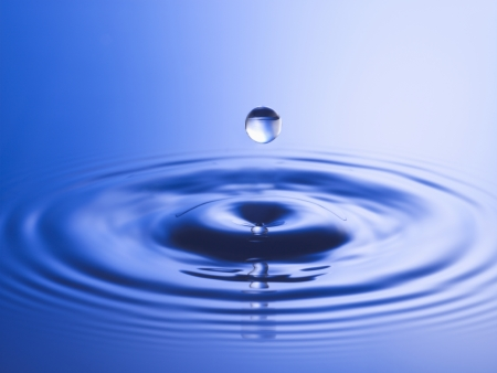 Drop hitting surface of water close-up Stock Photo - 19075790