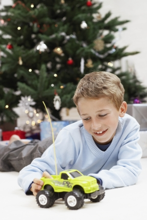 domesticity: Little Boy Playing with Toy Truck