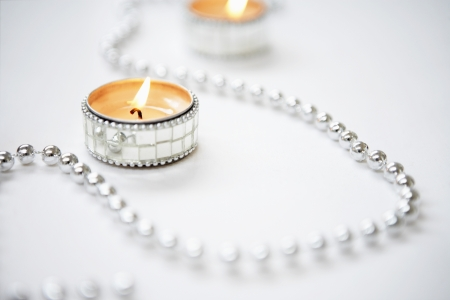 Tealight Candles and Silver Garland Stock Photo - 18885221