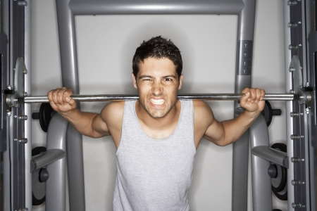 Man Grimacing while Lifting Weights Stock Photo - 18885811