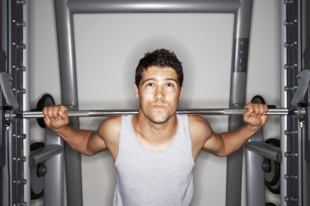 exerting: Man Lifting Weights