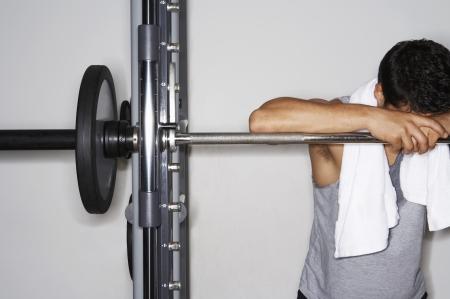 perspiring: Weightlifter Resting