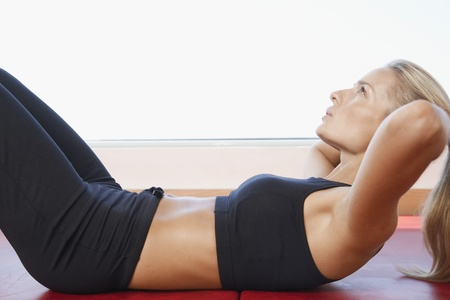 Woman Doing Sit-Ups Stock Photo - 18885220