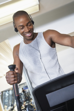 Man Using Elliptical Trainer