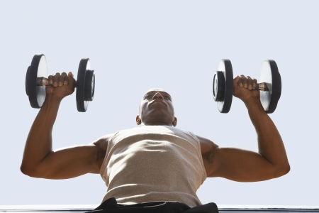 muscle toning: Man Lifting Weights