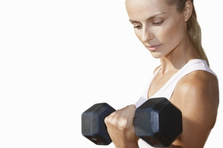 enhanced healthy: Woman Lifting Dumbbell