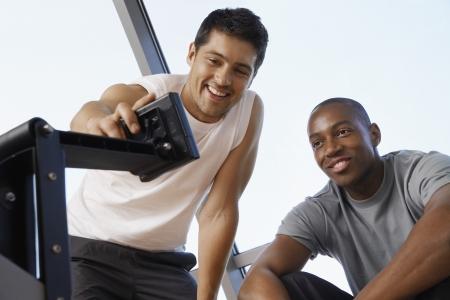well beings: Men Using Workout Equipment