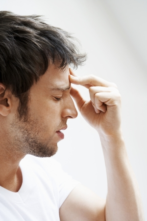 only one person: Man with Headache touching forehead