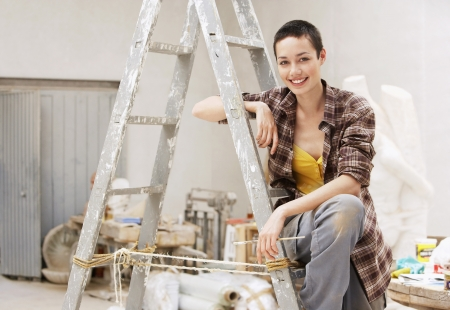 crewcut: Young Woman on Ladder LANG_EVOIMAGES