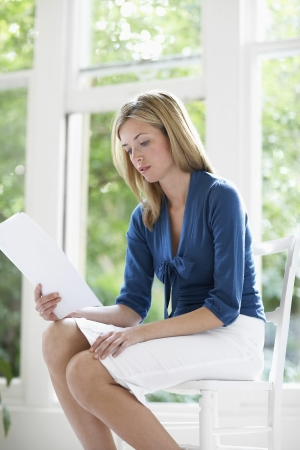 getting late: Young Businesswoman Reading Document