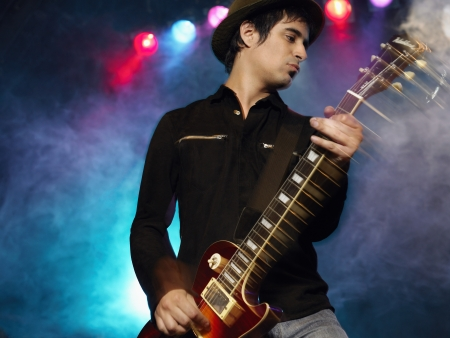 Rock Guitarist on stage in Concert low angle view front view Stock Photo - 19213794