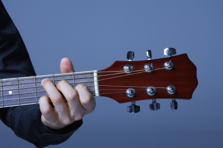 Hand Playing on Neck of Guitar detail close-up Stock Photo - 19213541