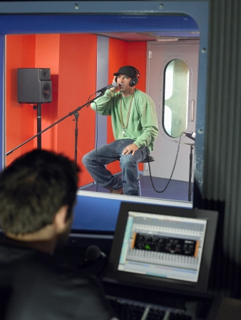 labouring: Young Man Singing in Studio