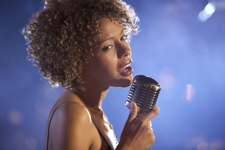 vocalist: Jazz singer on stage portrait LANG_EVOIMAGES
