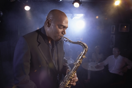 jazz music: Saxophonist Performing in Jazz Club LANG_EVOIMAGES