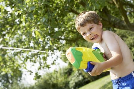 misbehaving: Boy Shooting Squirt Gun