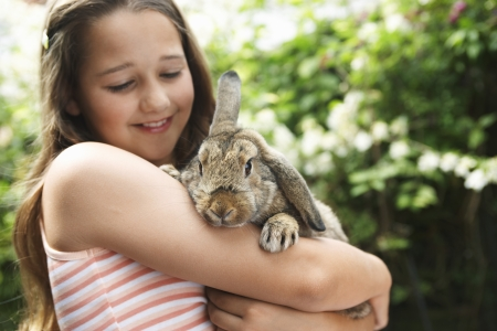 bunny rabbit: Girl Holding Rabbit