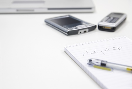 Meeting Note by personal data assistant laptop and cell phone close up Stock Photo - 19075913