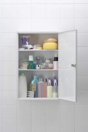 medicine cabinet: Various cosmetics and bath products in bathroom cabinet