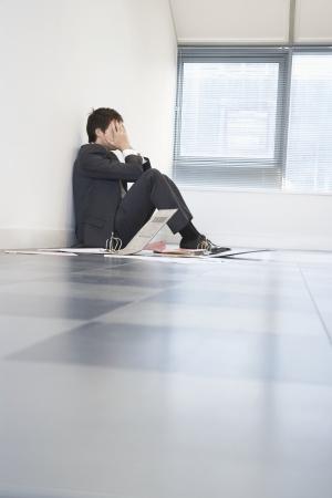 anguished: Despaired Businessman Sitting on Floor