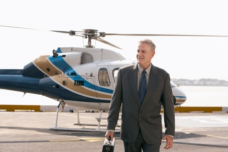 helicopter pad: Businessman arriving on helicopter pad LANG_EVOIMAGES