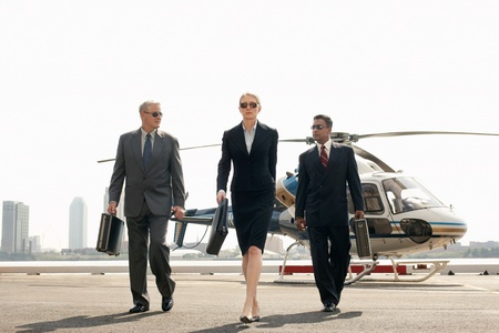 helicopter pad: Businesspeople arriving from helicopter